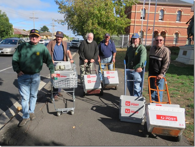 Kyneton Lions Club members transport the takings from the RCH appeal to the bank.