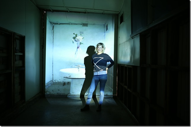 Georgie Mattingley is pictured with one of her installations at the old Ajax foundry in Kyneton.