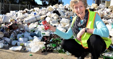 Mount Alexander Shire's Cr Christine Henderson with a pile of recyclables at Castlemaine landfill site last week. Cr Henderson wants federal leadership to address the nation's big waste and recycling challenges.