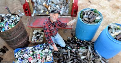 Castlemaine's Bill Wiglesworth - with some of the litter he collected beside the Pyrenees Highway just west of Elphinstone - is lobbying the state government for a container recycling deposit scheme.