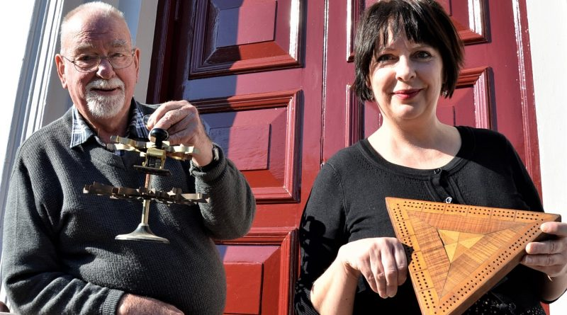 Pioneers and Old Residents Association secretary Wilson Bunton and Castlemaine library officer Donna Steven with some of the curiosities to feature in Chronicles and Curiosities of old Castlemaine.