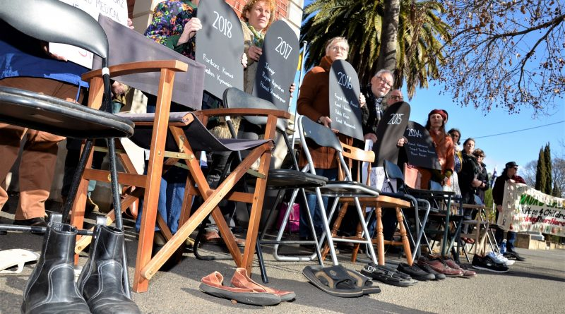 Empty chairs and empty shoes at last Thursday's rally in Castlemaine symbolised lives lost in detention centres at Manus or Nauru over the past five years.