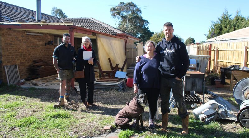 From left: Luke Mills of Next Level Property Maintenance, Erica Gray from Reece Plumbing Sunbury, disability pensioner Nikki Anticevic and David Cannon with David's dog Jazz.