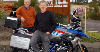 Greg Barkla and Bob Bent with Bob's bike and Winston the Black Dog mascot at The Mill in Castlemaine.
