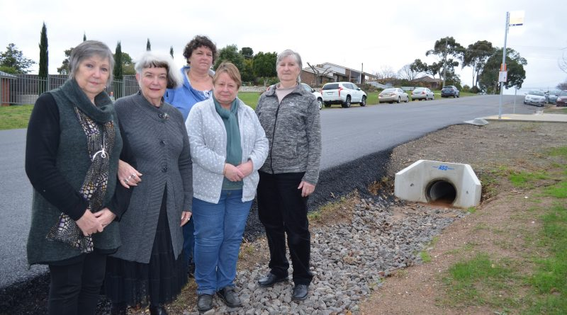 Goldfields Quilters Brenda, Beverley, Glenda, Kathy and Chris are among those concerned about the dangers of the deep guttering outside the Leisterville hall.