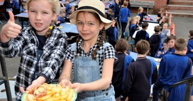 Young Ainsley Nash and Kate Hemphill dressed in farm-themed attire especially for Castlemaine Primary School's Parma for a Farmer lunch on Friday.