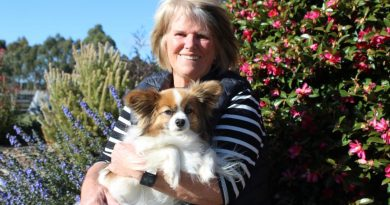 Marita is pictured with her canine companion Alfie.