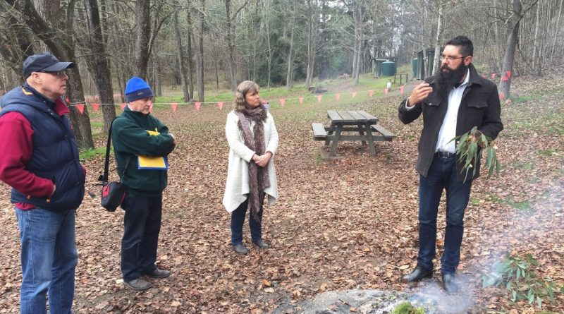 Mr Trent Nelson Dja Dja Wurrung Clans Aboriginal Corporation Traditional Owner conducts a Welcome to Country ceremony with VEAC Council members Dr Charles Meredith, Dr Geoffrey Wescott and Ms Joanne Duncan (left to right) at Mount Franklin.