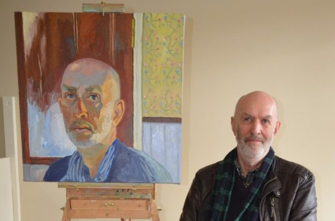 Castlemaine artist Mark Dober is pictured with his self-portrait.