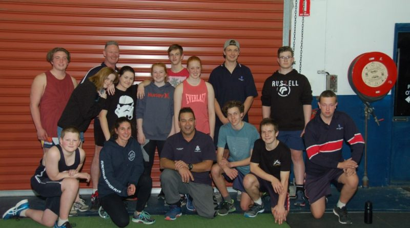Macedon Ranges youth resources officer Jason Azzopardi (centre) with the kids from KidzFlip's gym program.