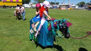 many hours went into turning these young Bendigo riders into mermaids on their seahorse in the popular fancy dress competition.