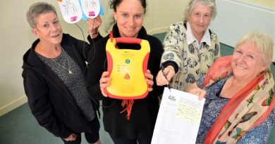 Community health nurse Bronwyn Grieve (holding a defibrillator) with CDCH volunteers Kaye Bourke, Joan White and Lyn Hall are supporting the petition for a public after-hours defibrillator.