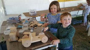 Happiness is a hammer and a screwdriver to make your own invention to take home in The Farm Workshop.