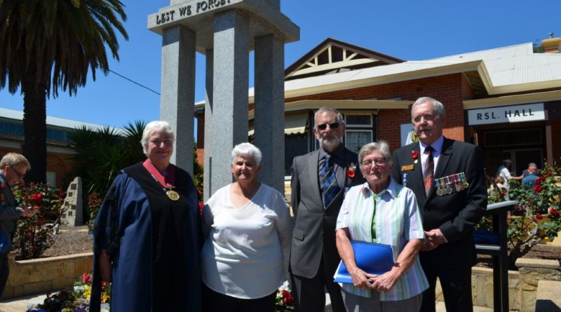 Mayor Bronwen Machin, Castlemaine RSL secretary Barb Templar, RSL president John Whiddon, guest speaker Hetty Veldman and MC Alan Lane are pictured alongside the cenotaph at the 100th anniversary event.