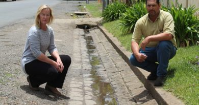 Edgecombe Street residents Helen and Dale Gillis are fighting a council plan to rip up the 180-year-old bluestone guttering in their street.
