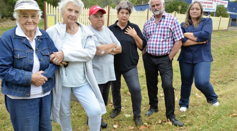Local residents are pictured at the site of the proposed billboard earlier this year. Photo: Eve Lamb
