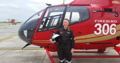 Amy Miller pictured with a Firebird 306 at Microflite headquarters at Moorabbin Airport.
