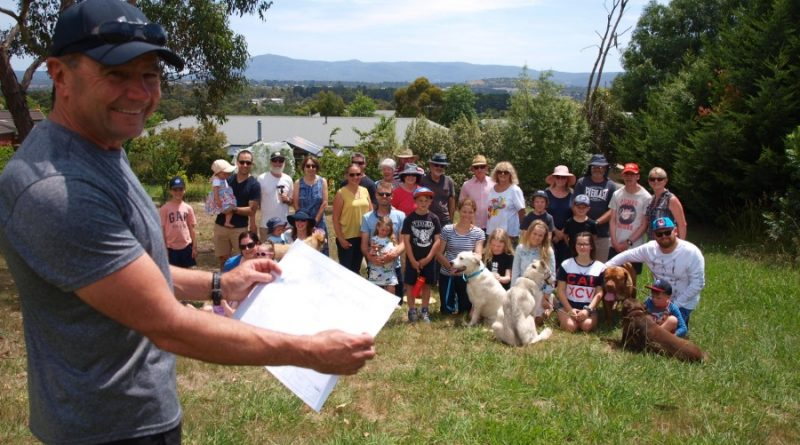 Friends of Wyralla Reserve treasurer John Wren shares the Reserve Landscape Plan with the many Gisborne residents keen to see the space developed for recreational community use.