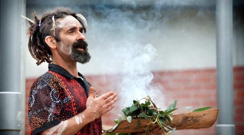 "Proud Dja Dja Wurrung man Damien Saunders conducts a smoking ceremony at Trentham District Primary School last Friday morning to celebrate the installation of a new flag pole to fly the Aboriginal flag. ""This ceremony today was the new beginning through the old for tomorrow's youth,"" he said. Photo: Sandy Scheltema"