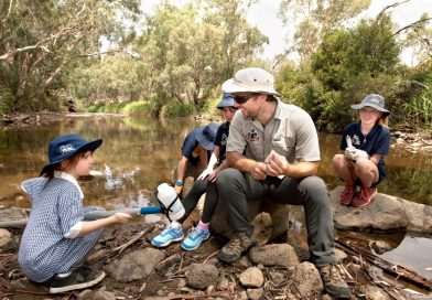 Grade one student from Redesdale Mia Mia Primary School Lili Arnephy learns how to collect and filter water for DNA sampling from platypus ecologist Josh Griffith on the Campaspe River in Redesdale last Monday. Photo: Sandy Scheltema