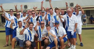 Celebration mode: Central Highlands players and officials after the historic Courier Shield victory at Dunolly.