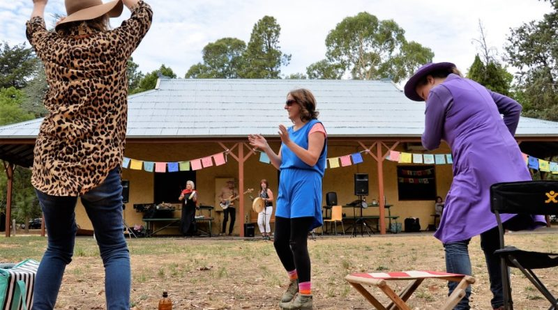 Cate Mercer of Castlemaine, Gen Ward of Castlemaine and Beverley Hope of Guildford couldn't resist the chance to get up and dance during Friday's International Women's Day celebration in the botanical gardens.