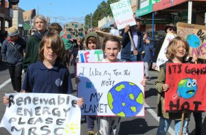 Hundreds of young people gathered in Kyneton to march down Mollison Street with banners and chants to ensure their voices were heard.