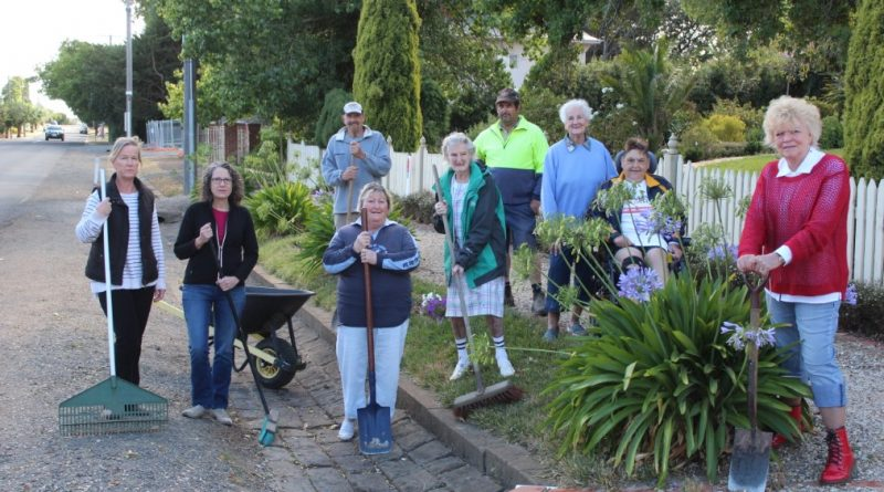 Helen Gillis, Lydia Beshara, Alf Holmes, Julie Edmondston, Shirley Francis, Dale Gillis, Betty McClure, Carole Hemming and Dawn Holmes have maintained their treasured bluestone gutters for decades.