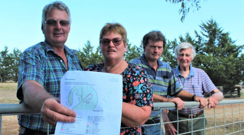 Hank and Robyn Bruger with neighbours Glenn and John Langdon want the local council to lift an outdated overlay that's causing headaches for Monegeetta.