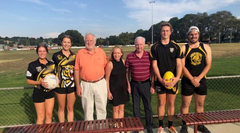 From left: Maddie Copeland (netballer), Bed Ingleton (netballer), Ian Jackson (RSL treasurer), Karen O'Sullivan, Mike Gretton (secretary) Evan Davie (U18 player) Hayden Clapham ( U18 player) at the cheque handover to rid the KFNC of its lighting debt.