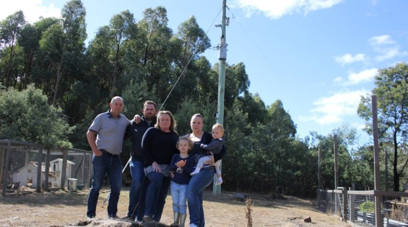 Phil Thomas, Sholto Arnold, Gill Walker and Christine Arnold, with children Eliza and Mac, will not see the Powerline Replacement Program rolled out to their roads as planned.